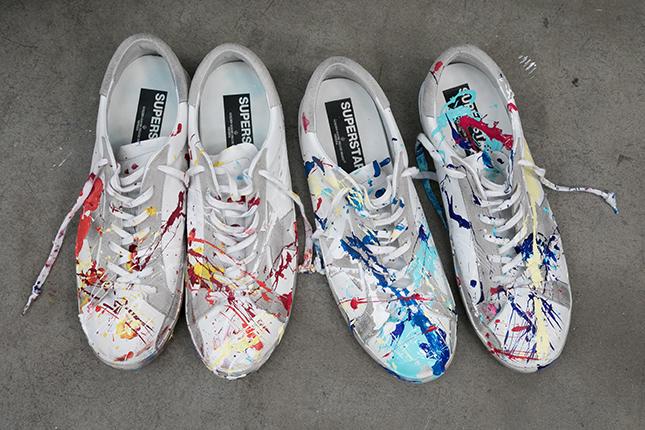 adidas con schizzi di vernice scarpe