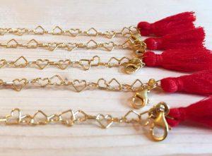 bracciale in argento con cuori e nappine bidivi